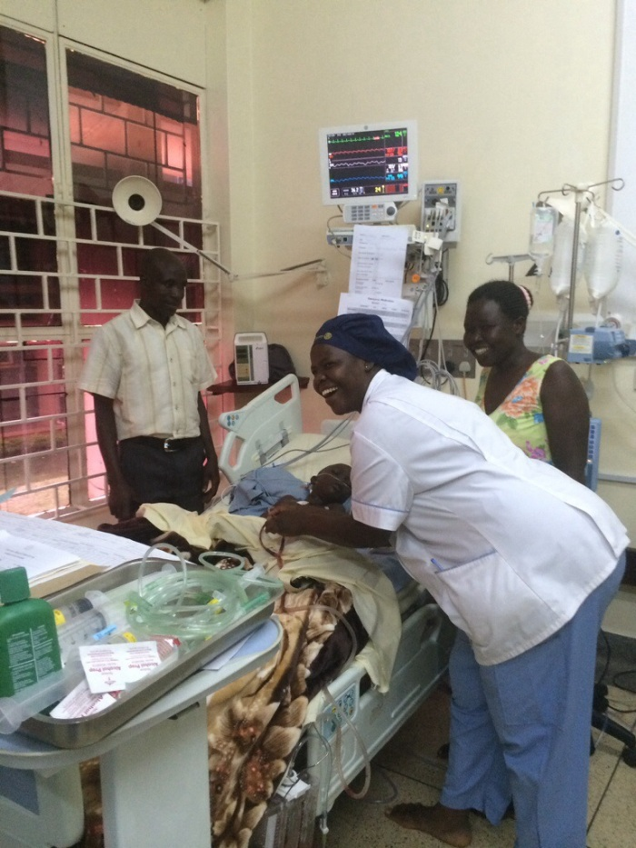 Kombe Dennis and his wife Molly with Fredrick and wonderful UHI nurse Sylvia!