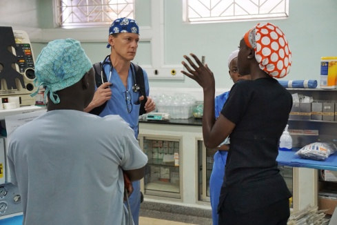 Dr. Scott Walker going over the first case of the day with the Uganda Anesthesia team