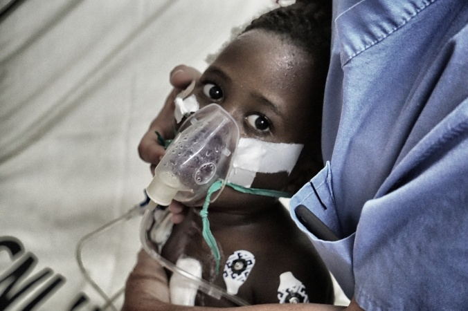 Our nurses working to help open up Saidat's left lung. Despite her haunting stare she improved greatly throughout the day.